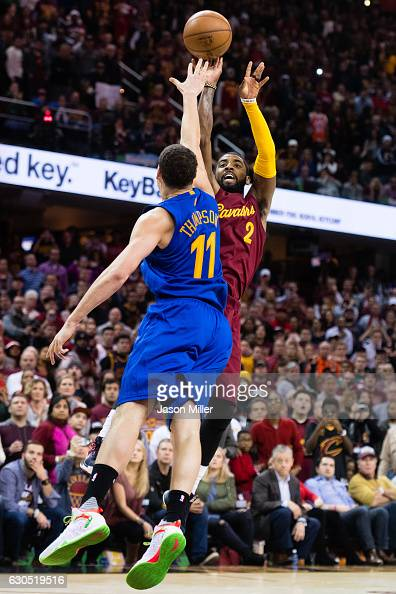 Kyrie Irving of the Cleveland Cavaliers shoots over Klay Thompson of the Golden State Warriors to win the game in the final seconds at Quicken Loans...