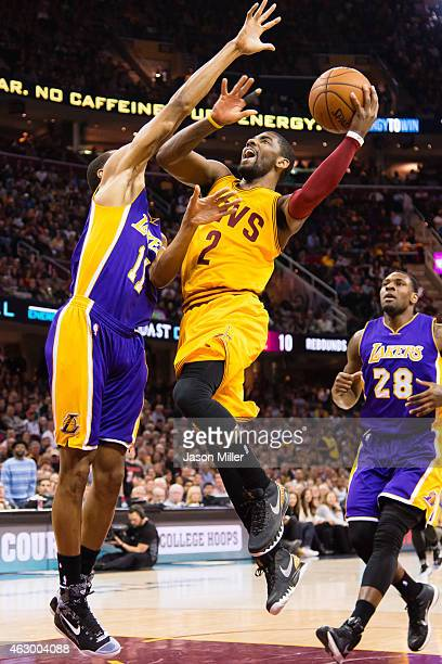 Kyrie Irving of the Cleveland Cavaliers shoots over Wesley Johnson of the Los Angeles Lakers during the first half at Quicken Loans Arena on February...