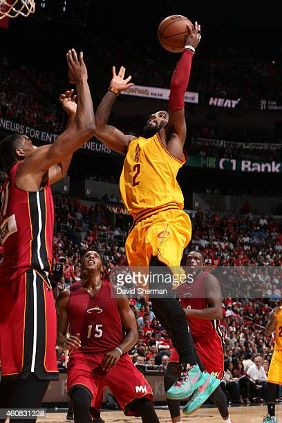 Kyrie Irving of the Cleveland Cavaliers shoots shoots during a game against the Miami Heat at the American Airlines Arena on December 25 2014 in...