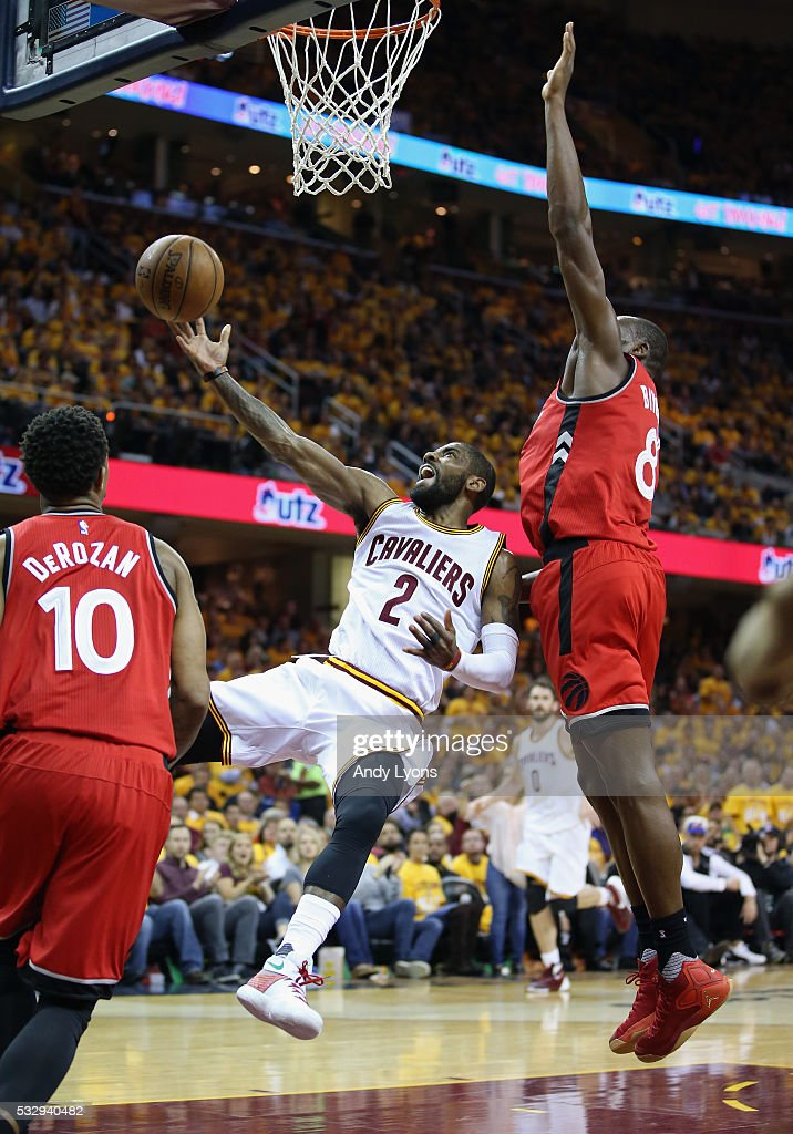 Kyrie Irving of the Cleveland Cavaliers shoots the ball against Bismack Biyombo of the Toronto Raptors during the second half in game two of the...