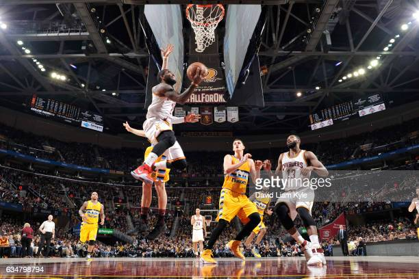 Kyrie Irving of the Cleveland Cavaliers shoots the ball against the Denver Nuggets on February 11 2017 at Quicken Loans Arena in Cleveland Ohio NOTE...