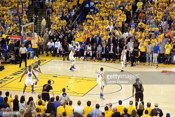 Kyrie Irving of the Cleveland Cavaliers shoots the winning threepoint shot during the game against Stephen Curry of the Golden State Warriors during...