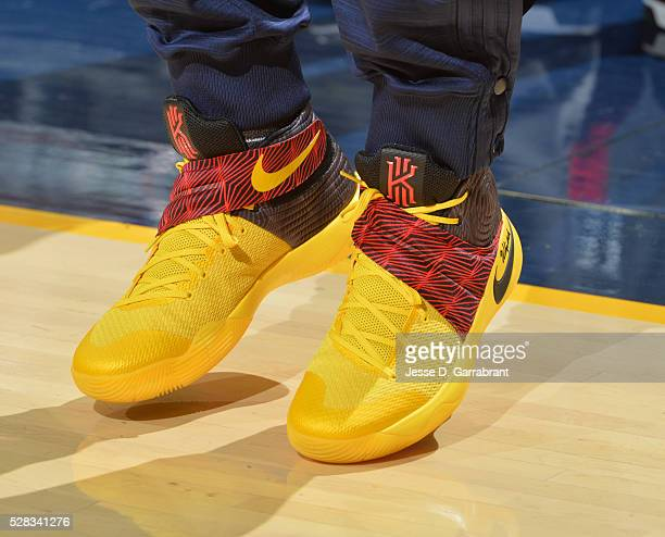 Kyrie Irving of the Cleveland Cavaliers showcases his sneakers against the Atlanta Hawks during the Eastern Conference Semifinals Game One on May 4...
