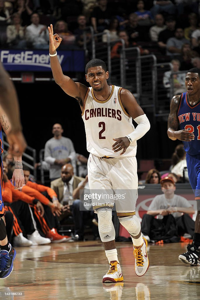<a gi-track='captionPersonalityLinkClicked' href=/galleries/search?phrase=Kyrie+Irving&family=editorial&specificpeople=6893971 ng-click='$event.stopPropagation()'>Kyrie Irving</a> #2 of the Cleveland Cavaliers signifies the three pointer hit by teammate <a gi-track='captionPersonalityLinkClicked' href=/galleries/search?phrase=Manny+Harris&family=editorial&specificpeople=4683139 ng-click='$event.stopPropagation()'>Manny Harris</a> #6 (not pictured) to put them up by 15 late in the fourth quarter against the New York Knicks at The Quicken Loans Arena on April 20, 2012 in Cleveland, Ohio.
