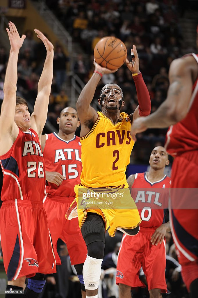 Kyrie Irving #2 of the Cleveland Cavaliers sinks a three pointer as time expires in the first half against the Atlanta Hawks at The Quicken Loans Arena on December 28, 2012 in Cleveland, Ohio.