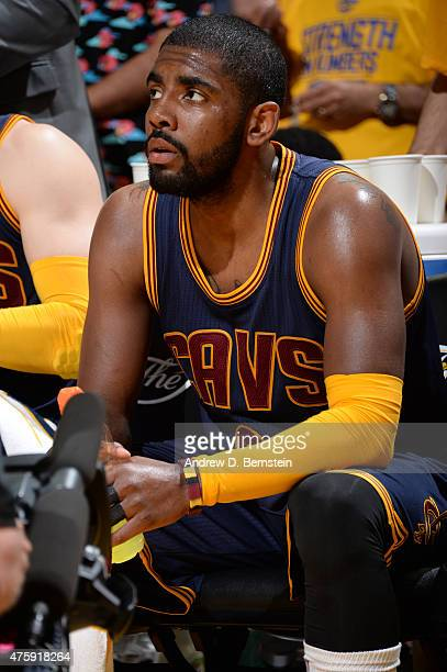 Kyrie Irving of the Cleveland Cavaliers sits on the bench during a timeout during Game One of the 2015 NBA Finals on June 4 2015 at Oracle Arena in...