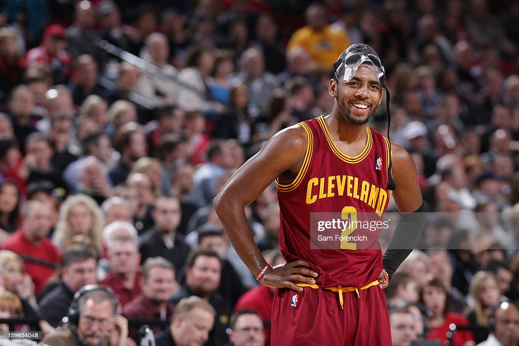 <a gi-track='captionPersonalityLinkClicked' href=/galleries/search?phrase=Kyrie+Irving&family=editorial&specificpeople=6893971 ng-click='$event.stopPropagation()'>Kyrie Irving</a> #2 of the Cleveland Cavaliers smiles during the game against the Portland Trail Blazers on January 16, 2013 at the Rose Garden Arena in Portland, Oregon.
