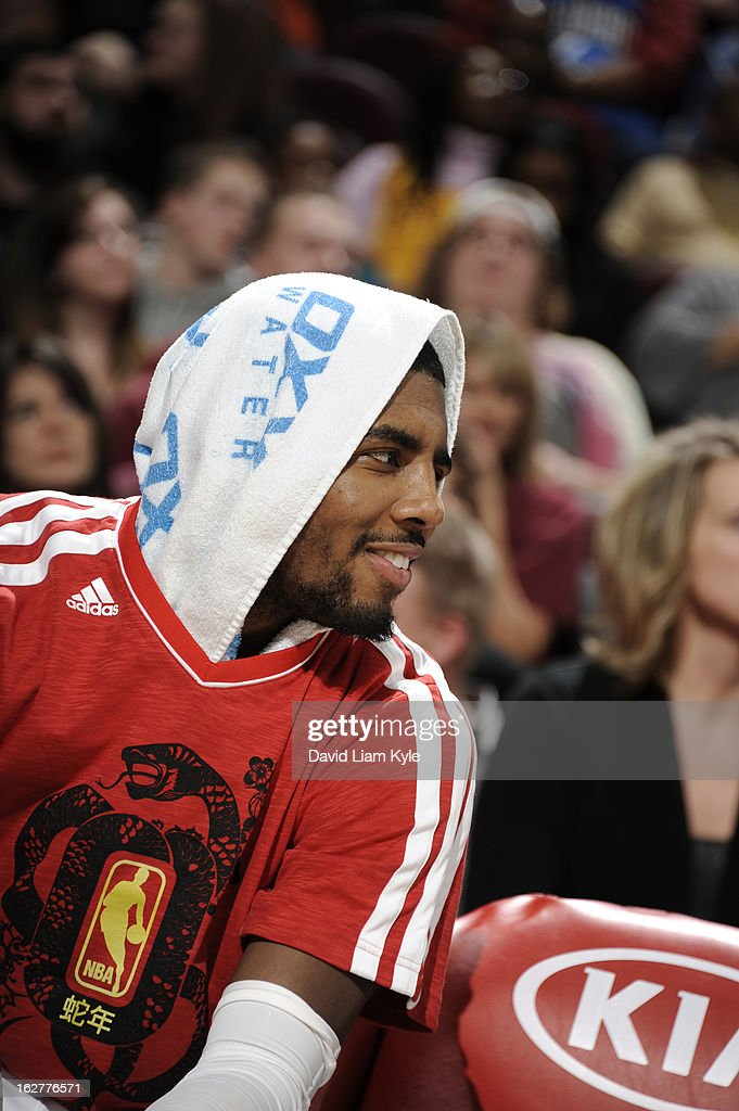 <a gi-track='captionPersonalityLinkClicked' href=/galleries/search?phrase=Kyrie+Irving&family=editorial&specificpeople=6893971 ng-click='$event.stopPropagation()'>Kyrie Irving</a> #2 of the Cleveland Cavaliers smiles on the bench during the game against the Orlando Magic at The Quicken Loans Arena on February 8, 2013 in Cleveland, Ohio.