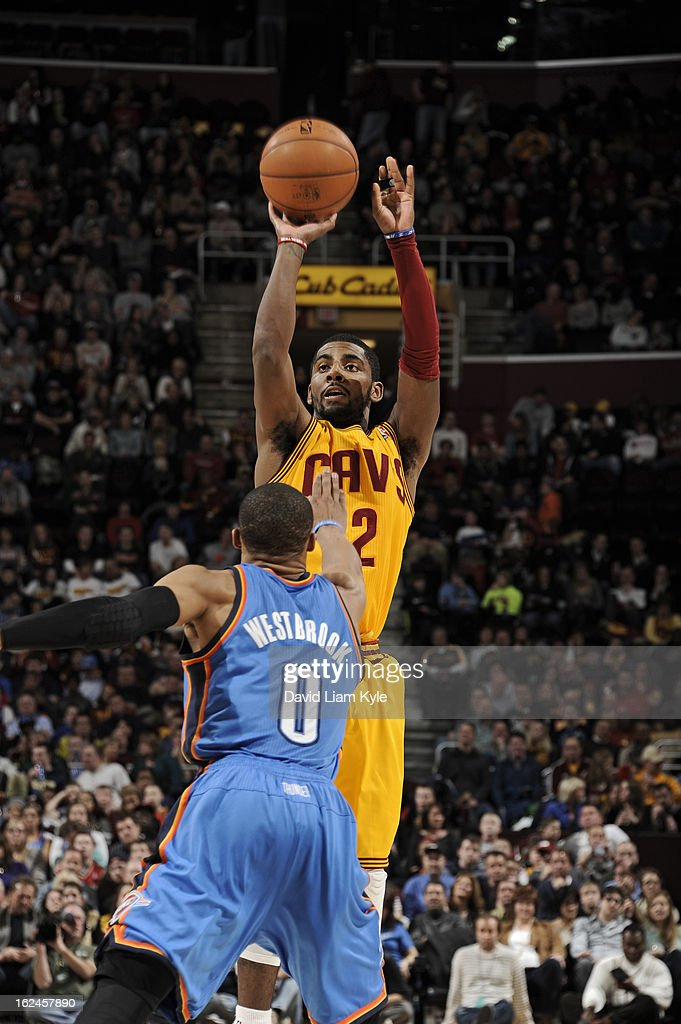 <a gi-track='captionPersonalityLinkClicked' href=/galleries/search?phrase=Kyrie+Irving&family=editorial&specificpeople=6893971 ng-click='$event.stopPropagation()'>Kyrie Irving</a> #2 of the Cleveland Cavaliers takes a shot against <a gi-track='captionPersonalityLinkClicked' href=/galleries/search?phrase=Russell+Westbrook&family=editorial&specificpeople=4044231 ng-click='$event.stopPropagation()'>Russell Westbrook</a> #0 of the Oklahoma City Thunder at The Quicken Loans Arena on February 2, 2013in Cleveland, Ohio.