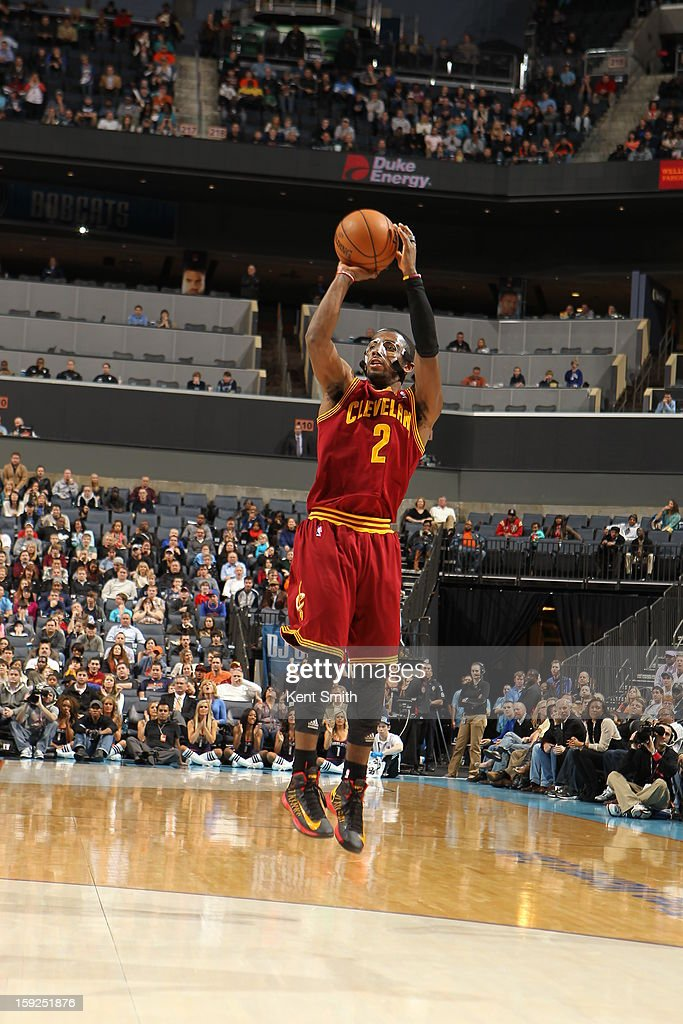 <a gi-track='captionPersonalityLinkClicked' href=/galleries/search?phrase=Kyrie+Irving&family=editorial&specificpeople=6893971 ng-click='$event.stopPropagation()'>Kyrie Irving</a> #2 of the Cleveland Cavaliers takes a shot against the Charlotte Bobcats at the Time Warner Cable Arena on January 4, 2013 in Charlotte, North Carolina.