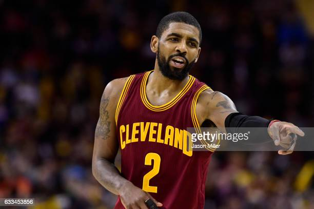 Kyrie Irving of the Cleveland Cavaliers talks to a teammate during the second half against the Minnesota Timberwolves at Quicken Loans Arena on...