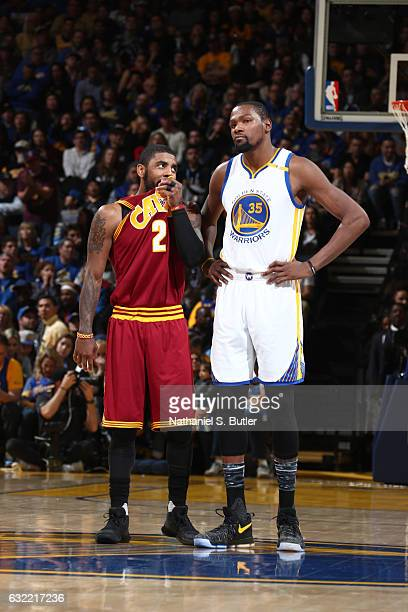Kyrie Irving of the Cleveland Cavaliers talks to Kevin Durant of the Golden State Warriors on January 16 2017 at ORACLE Arena in Oakland California...