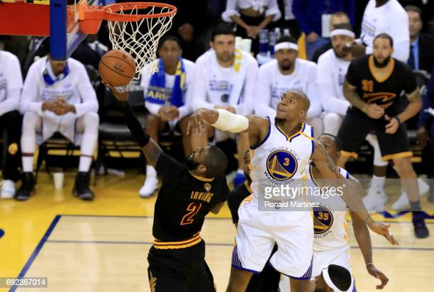 Kyrie Irving of the Cleveland Cavaliers throws up a shot against David West of the Golden State Warriors in Game 2 of the 2017 NBA Finals at ORACLE...