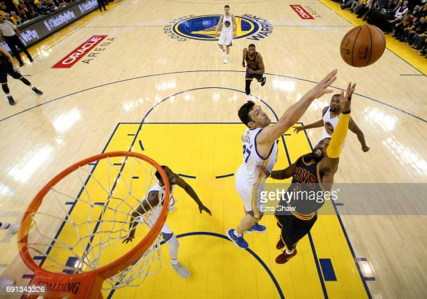 Kyrie Irving of the Cleveland Cavaliers throws up a shot against Zaza Pachulia of the Golden State Warriors in Game 1 of the 2017 NBA Finals at...