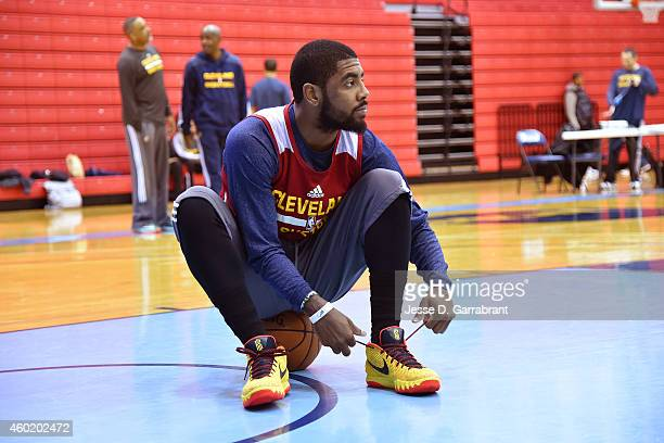 Kyrie Irving of the Cleveland Cavaliers ties his shoes at practice on December 7 2014 at Baruch College in New York New York NOTE TO USER User...