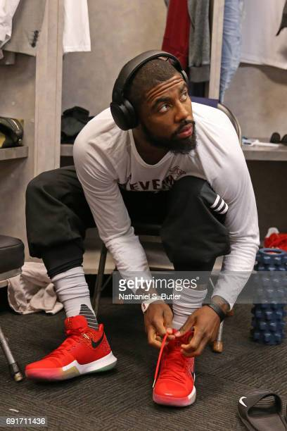 Kyrie Irving of the Cleveland Cavaliers ties his shoes before Game One of the 2017 NBA Finals against the Golden State Warriors on June 1 2017 at...