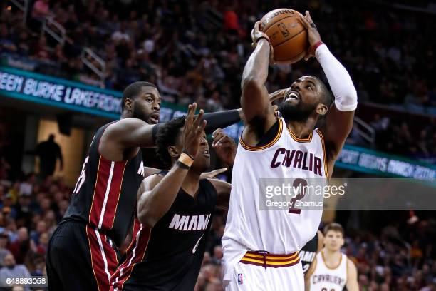 Kyrie Irving of the Cleveland Cavaliers tries to get a shot off next to Willie Reed and Josh Richardson of the Miami Heat during the second half at...