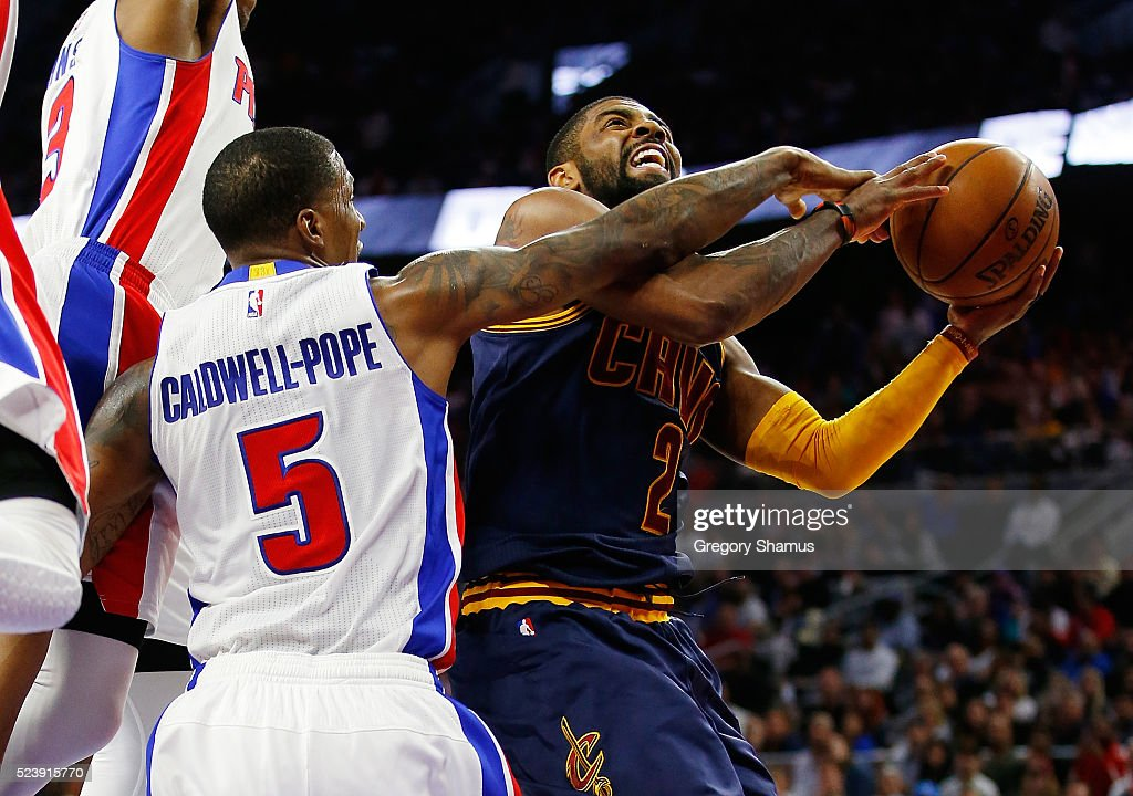 Kyrie Irving of the Cleveland Cavaliers tries to get to the basket in the third quarter past Kentavious CaldwellPope of the Detroit Pistons in game...