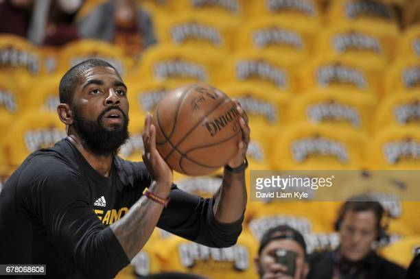 Kyrie Irving of the Cleveland Cavaliers warms up before the game against the Toronto Raptors during Game Two of the Eastern Conference Semifinals of...