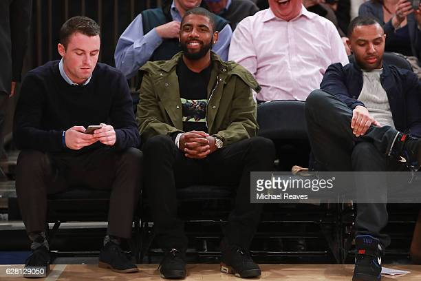 Kyrie Irving of the Cleveland Cavaliers watches from the sideline during the Jimmy V Classic at Madison Square Garden on December 6 2016 in New York...