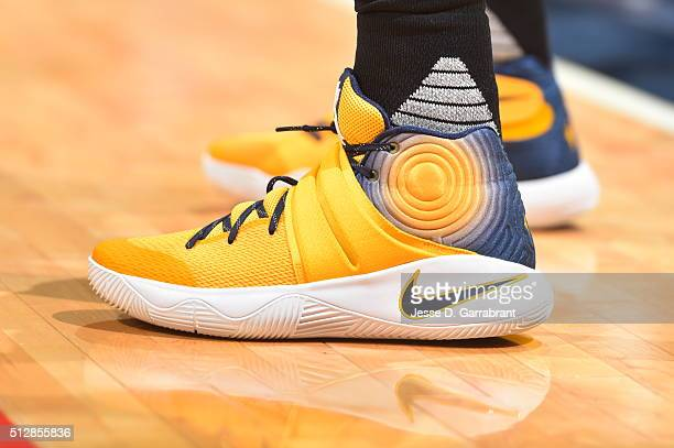 Kyrie Irving of the Cleveland Cavilers showcases his sneakers during the game against the Washington Wizards on February 28 2015 at Verizon Center in...