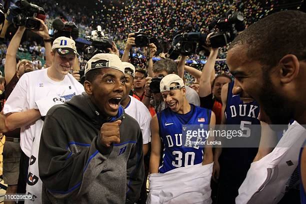 Kyrie Irving of the Duke Blue Devils celebrates with teammates after their 7558 victory over the North Carolina Tar Heels to win the championship...