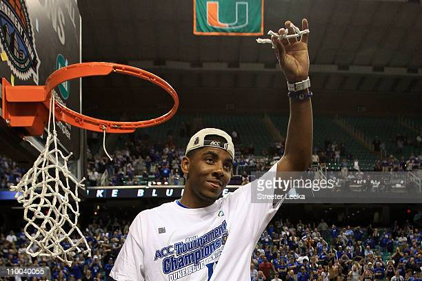 Kyrie Irving of the Duke Blue Devils cuts down the net after defeating the North Carolina Tar Heels 7558 in the championship game of the 2011 ACC...