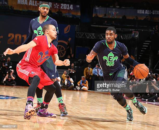 Kyrie Irving of the Eastern Conference AllStars drives against Stephen Curry of the Western Conference AllStars during the 2014 NBA AllStar Game as...