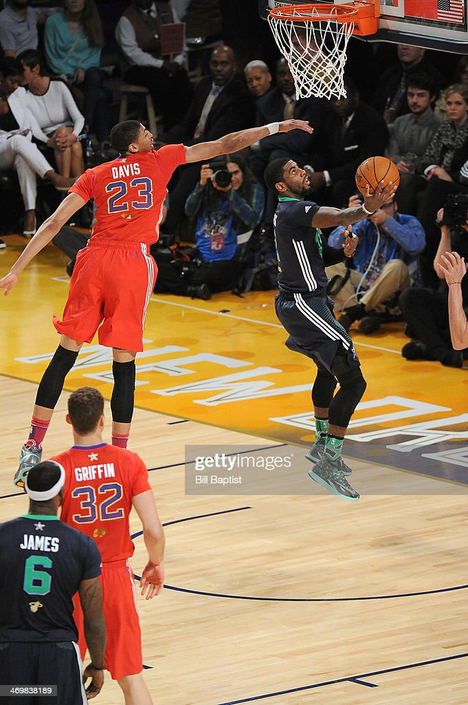 <a gi-track='captionPersonalityLinkClicked' href=/galleries/search?phrase=Kyrie+Irving&family=editorial&specificpeople=6893971 ng-click='$event.stopPropagation()'>Kyrie Irving</a> #2 of the Eastern Conference All-Stars shoots against Anthony Davis #23 of the Western Conference All-Stars during the 2014 NBA All-Star Game at Smoothie King Center on February 16, 2014 in New Orleans, Louisiana.