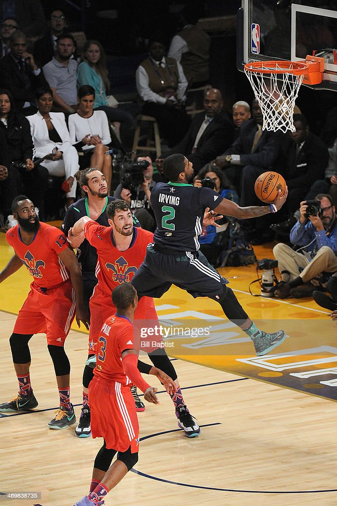 <a gi-track='captionPersonalityLinkClicked' href=/galleries/search?phrase=Kyrie+Irving&family=editorial&specificpeople=6893971 ng-click='$event.stopPropagation()'>Kyrie Irving</a> #2 of the Eastern Conference All-Stars shoots against <a gi-track='captionPersonalityLinkClicked' href=/galleries/search?phrase=Kevin+Love&family=editorial&specificpeople=4212726 ng-click='$event.stopPropagation()'>Kevin Love</a> #42 of the Western Conference All-Stars during the 2014 NBA All-Star Game at Smoothie King Center on February 16, 2014 in New Orleans, Louisiana.