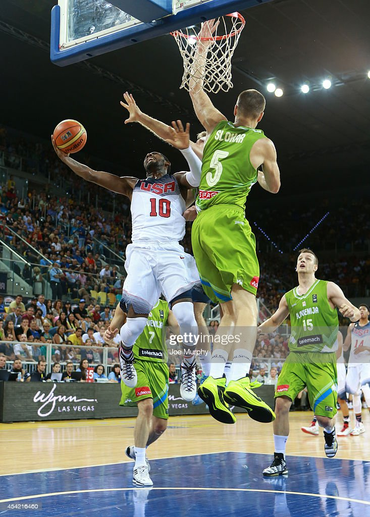 <a gi-track='captionPersonalityLinkClicked' href=/galleries/search?phrase=Kyrie+Irving&family=editorial&specificpeople=6893971 ng-click='$event.stopPropagation()'>Kyrie Irving</a> #10 of the USA Basketball Men's National Team handles the ball against the Slovenia Basketball Men's National Team on August 26, 2014 at Gran Canaria Arena in Las Palmas, Gran Canaria, Spain.
