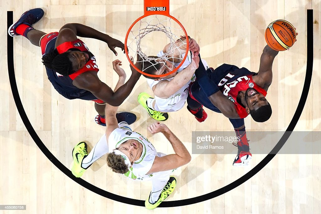 Kyrie Irving #10 of the USA Basketball Men's National Team shoots the ball against Slovenia Basketball Men's National Team during 2014 FIBA Basketball World Cup quarter-final match between Slovenia and USA at Palau Sant Jordi on September 9, 2014 in Barcelona, Spain.