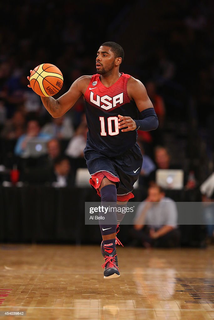 <a gi-track='captionPersonalityLinkClicked' href=/galleries/search?phrase=Kyrie+Irving&family=editorial&specificpeople=6893971 ng-click='$event.stopPropagation()'>Kyrie Irving</a> #10 of the USA dribbles against Puerto Rico during their game at Madison Square Garden on August 22, 2014 in New York City.