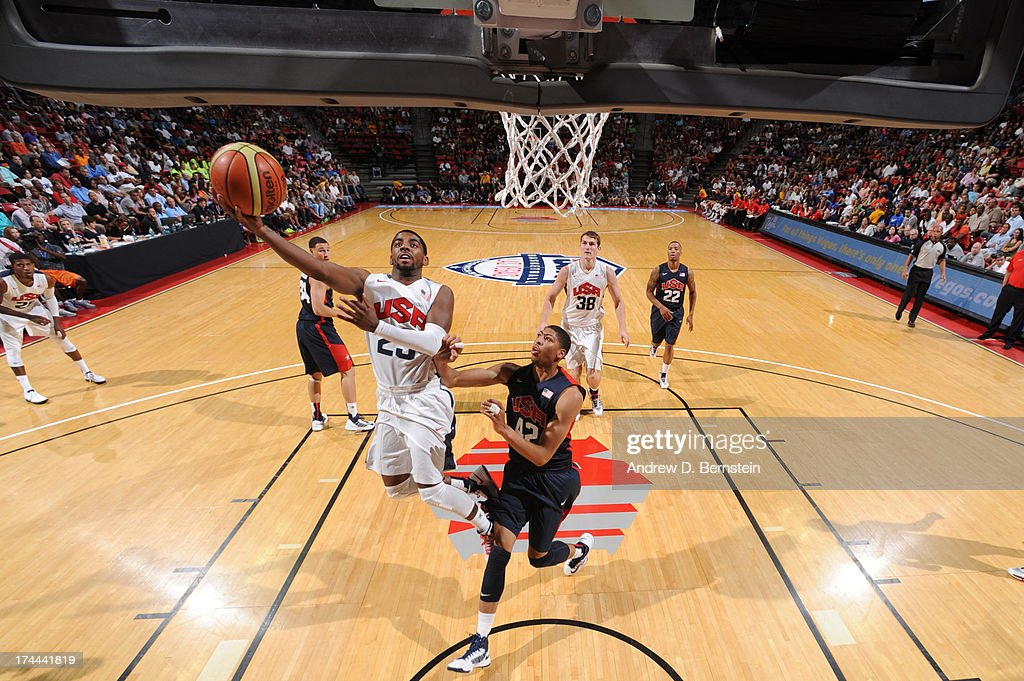 <a gi-track='captionPersonalityLinkClicked' href=/galleries/search?phrase=Kyrie+Irving&family=editorial&specificpeople=6893971 ng-click='$event.stopPropagation()'>Kyrie Irving</a> #23 of the USA White Team attempts a shot against Anthony Davis #42 of the USA Blue Team during the 2013 USA Basketball Showcase at the Thomas and Mack Center on July 25, 2013 in Las Vegas, Nevada.