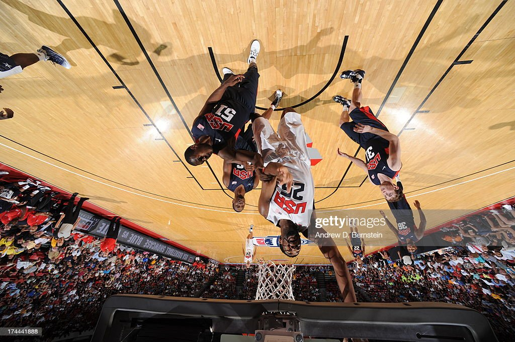 <a gi-track='captionPersonalityLinkClicked' href=/galleries/search?phrase=Kyrie+Irving&family=editorial&specificpeople=6893971 ng-click='$event.stopPropagation()'>Kyrie Irving</a> #23 of the USA White Team attempts a shot during the 2013 USA Basketball Showcase at the Thomas and Mack Center on July 25, 2013 in Las Vegas, Nevada.