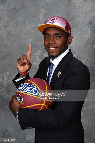 Kyrie Irving selected number one overall by the Cleveland Cavaliers poses for a portrait during the 2011 NBA Draft at The Prudential Center on June...