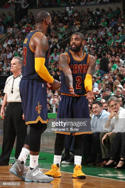 Kyrie Irving talks with LeBron James of the Cleveland Cavaliers during the game against the Boston Celtics in Game One of the Eastern Conference...