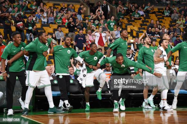 Kyrie Irving Terry Rozier and Al Horford of the Boston Celtics with their teammates celebrates a win against the Philadelphia 76ers during the...