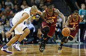 Kyrie Irving watches as teammates LeBron James of the Cleveland Cavaliers dives for a loose ball against Nicolas Batum of the Charlotte Hornets...