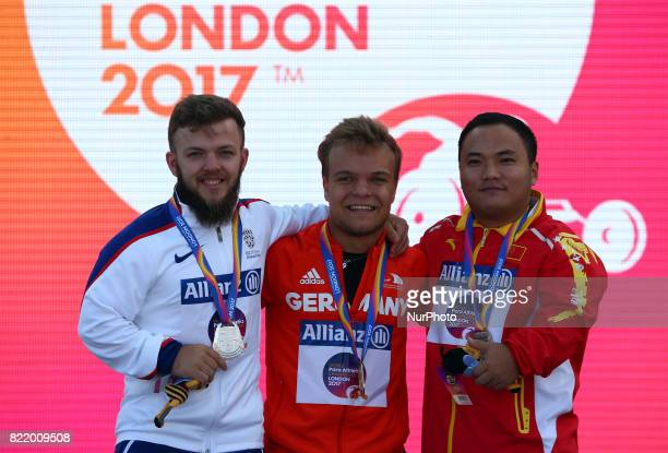 LR Kyron Duke of Great bRITAIN Niko Kappel of Germany and Zhiwei Xia of China during World Para Athletics Championships at London Stadium in London...