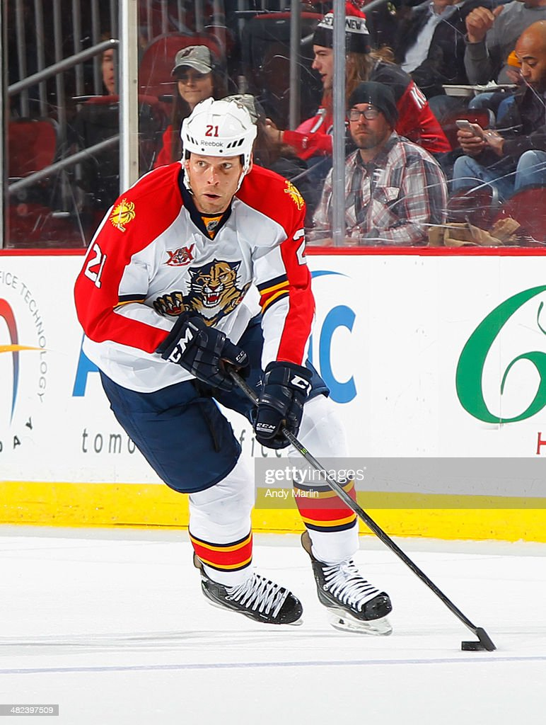 Kyrs Barch of the Florida Panthers plays the puck against the New Jersey Devils during the game at the Prudential Center on March 31 2014 in Newark...