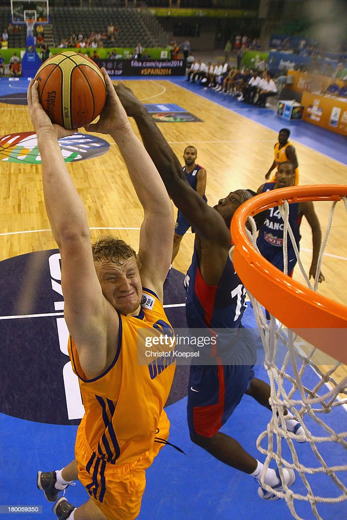 Kyryl Natyazhko of Ukriane dunks the ball against <a gi-track='captionPersonalityLinkClicked' href=/galleries/search?phrase=Mickael+Gelabale&family=editorial&specificpeople=700549 ng-click='$event.stopPropagation()'>Mickael Gelabale</a> of France during the FIBA European Championships 2013 first round group A match between Ukraine and France at Tivoli Arena on September 8, 2013 in Ljubljana, Slovenia.