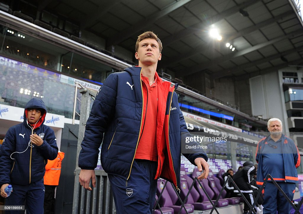 Kystian Bielik of Arsenal checks out the stadium before the match between Anderlecht and Arsenal at Constant Vanden Stock Stadium on February 9, 2016 in Brussels, Bruxelles-Capitale, Region de.