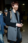 Kyuhyun of boy band Super Junior M is seen upon arrival at Incheon International Airport on February 25 2013 in Incheon South Korea