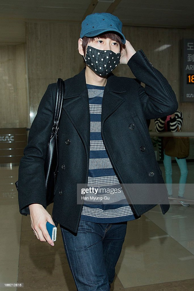 Kyuhyun of boy band Super Junior M is seen upon arrival at the Gimpo Airport on October 28 2013 in Seoul South Korea