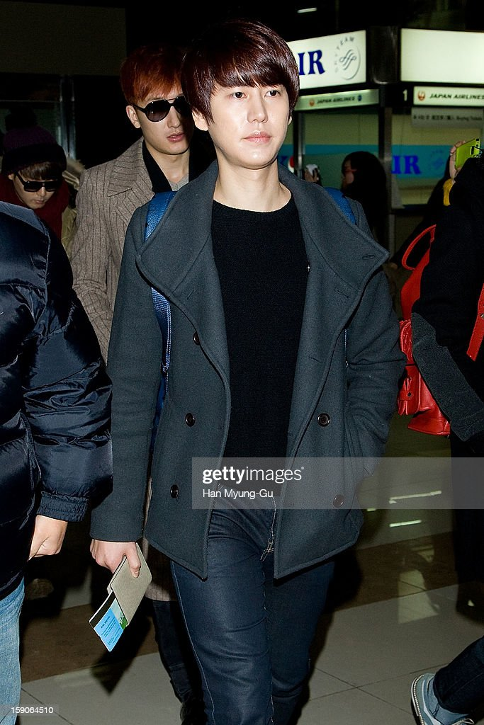 Kyuhyun of South Korean boy band Super Junior is seen at Gimpo International Airport on January 7, 2013 in Seoul, South Korea.