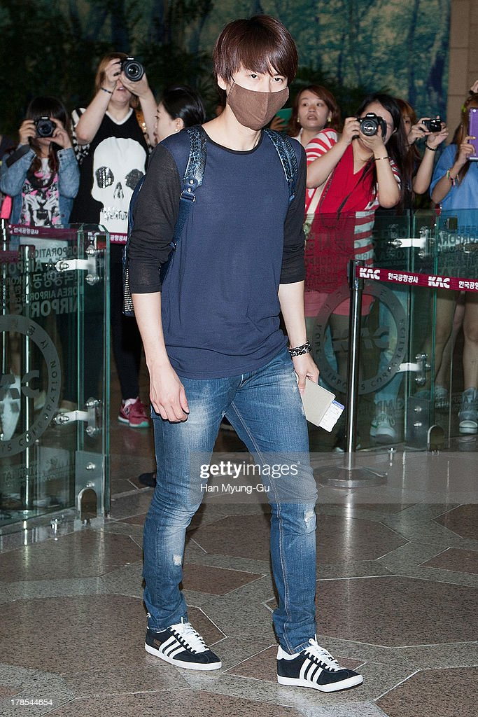 Kyuhyun of South Korean boy band Super Junior is seen on departure at Gimpo International Airport on August 30, 2013 in Seoul, South Korea.