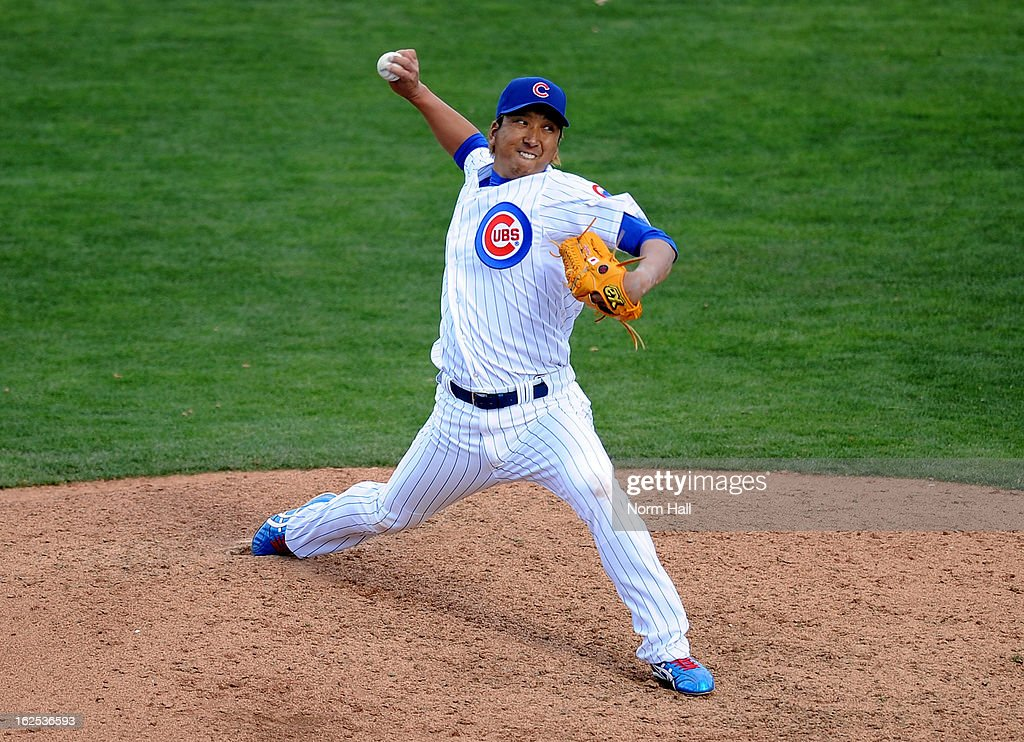 <a gi-track='captionPersonalityLinkClicked' href=/galleries/search?phrase=Kyuji+Fujikawa&family=editorial&specificpeople=807185 ng-click='$event.stopPropagation()'>Kyuji Fujikawa</a> #11 of the Chicago Cubs delivers a pitch against the San Francisco Giants on at HoHoKam Park on February 24, 2013 in Mesa, Arizona.
