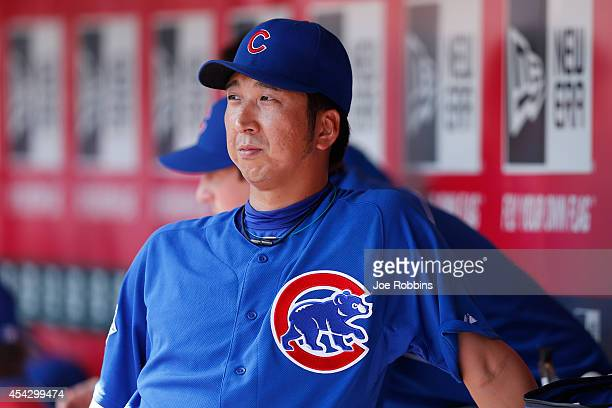 Kyuji Fujikawa of the Chicago Cubs looks on after pitching in the eighth inning of the game against the Cincinnati Reds at Great American Ball Park...
