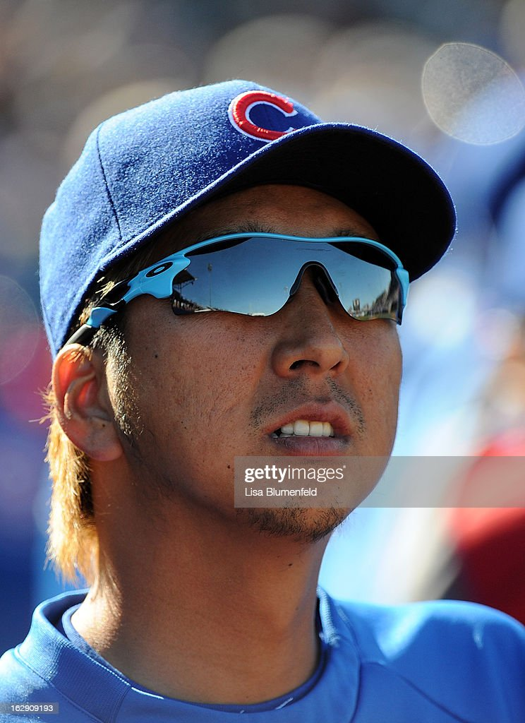 <a gi-track='captionPersonalityLinkClicked' href=/galleries/search?phrase=Kyuji+Fujikawa&family=editorial&specificpeople=807185 ng-click='$event.stopPropagation()'>Kyuji Fujikawa</a> #11 of the Chicago Cubs looks on during the game against the Los Angeles Dodgers on February 27, 2013 at HoHoKam Park in Mesa, Arizona.